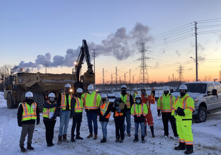 Sterling Ridge Group workers posing on construction site wearing masks