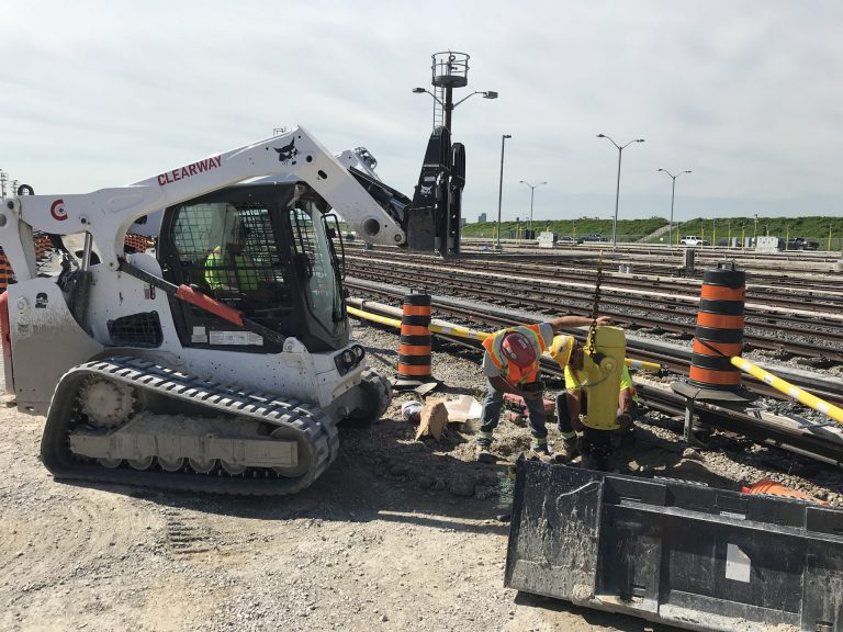 Clearway construction machine and worker on site