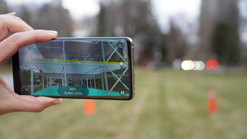 augmented reality app on phone showing mock up of building