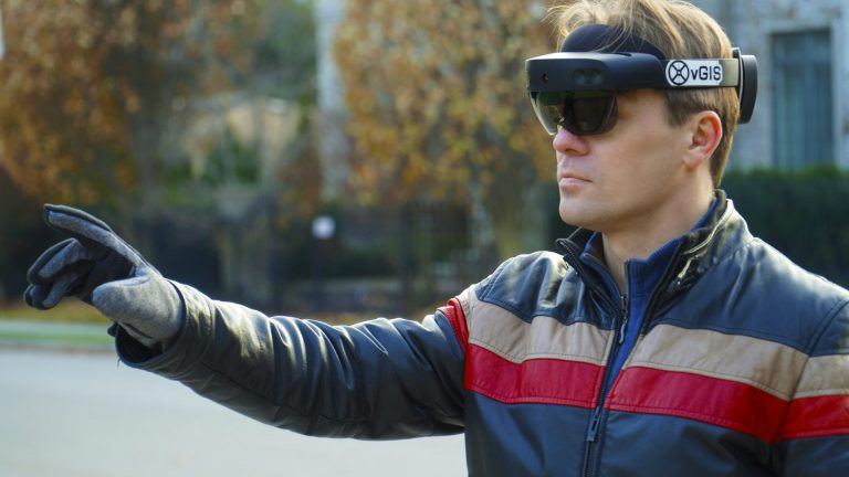 man wearing augmented reality glasses by vGIS Inc.