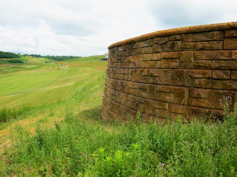 precast concrete block wall on golf course