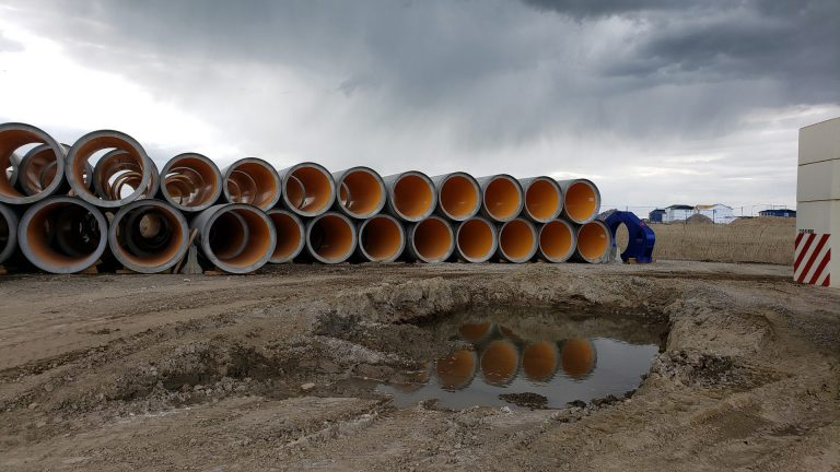 rows of stacked concrete pipes