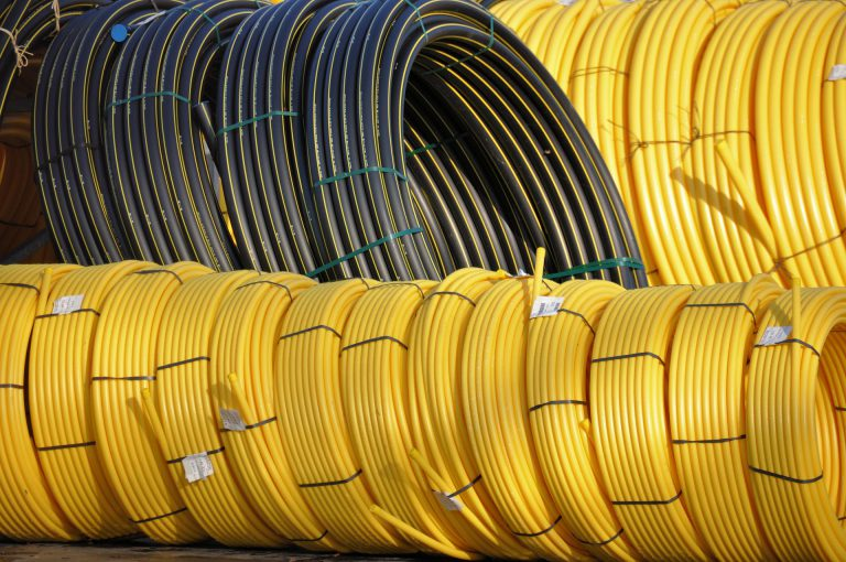 Plastic pipe coils yellow and black