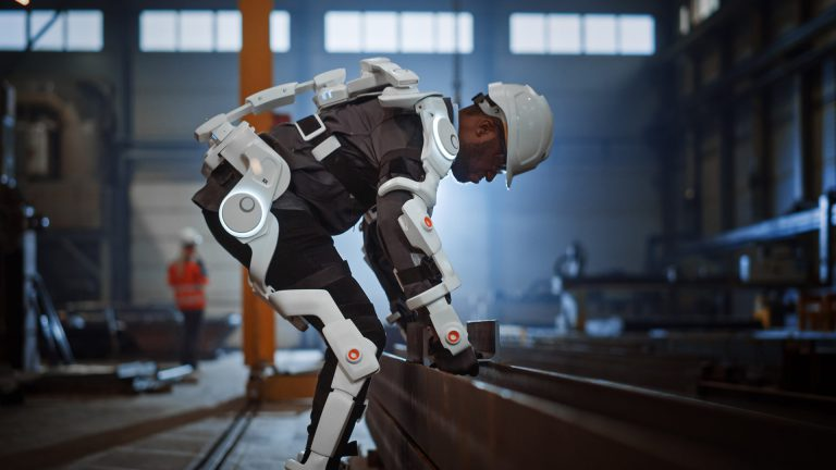 construction worker indoors wearing exoskeleton suit